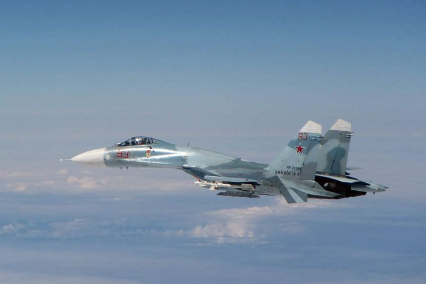 British Royal Air Force picture showing a Russian Su-27 Flanker that was intercepted by the Royal Air Force within NATO's area of interest, near Estonia, on May 17. The Russian aircraft - identified as four Su-27 Flanker fighters and one Coot-A commu