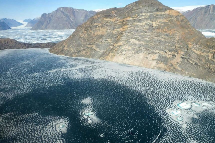 An aerial view of the fjord of Violin Glacier in the east-central region of Greenland taken on May 19, 2016 from NASA's IceBridge, an airborne survey of polar ice.