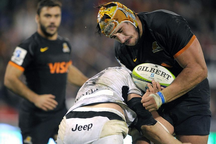 Jaguares' lock Tomas Lavanini (right) vies for the ball with Sharks' number 8 Daniel du Preez during their Super Rugby match.