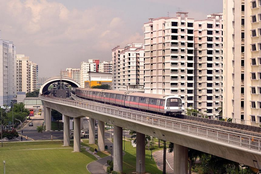 An SMRT train departs Pioneer Station on the East-West line.