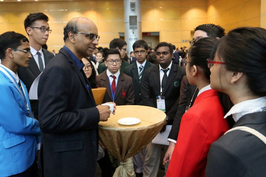 DPM Tharman speaking to participants of the Pre-University Seminar at the Nanyang Technological University yesterday. About 550 students from 30 pre-university institutions, including junior colleges and polytechnics, attended the event.