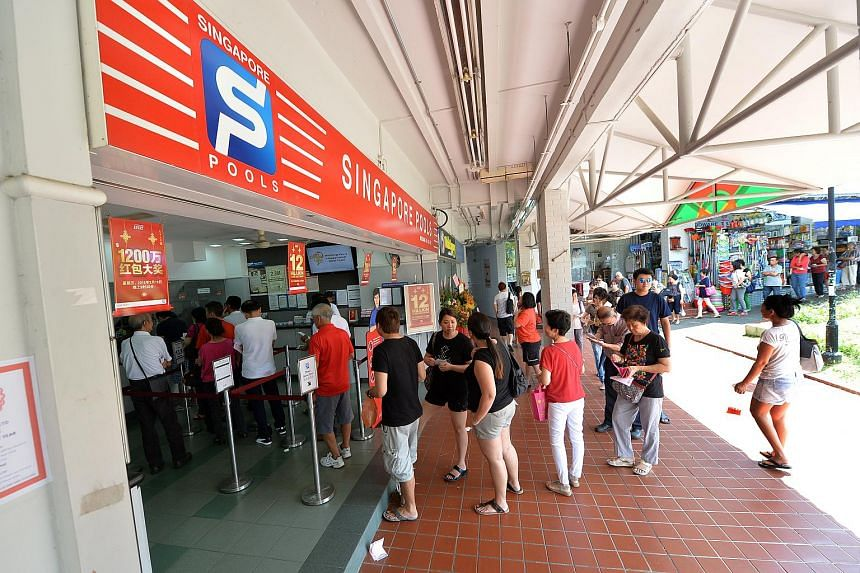 Punters in queue to buy lottery at Singapore Pools' Hougang Branch at Block 211 in Hougang Street 21 on February 17.