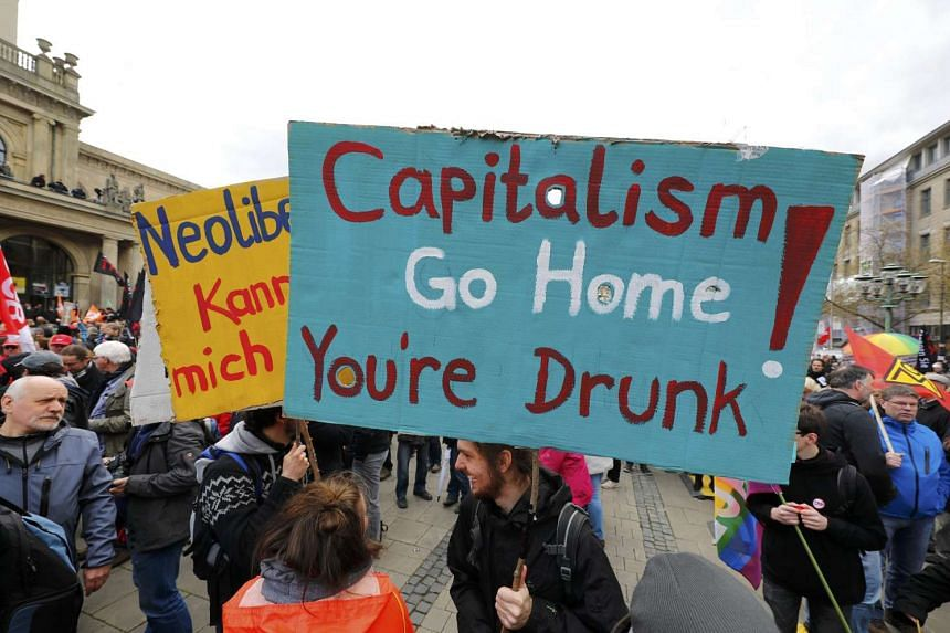 Protesters demonstrate against Transatlantic Trade and Investment Partnership free trade agreement in Hannover, Germany. The country slipped out of being in the 10 top list of most globally competitive countries this year.