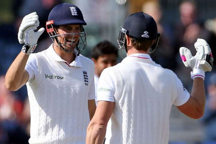 England's captain Alastair Cook (left) and teammate Nick Compton celebrate after winning the second Test match against Sri Lanka, on May 30, 2016.