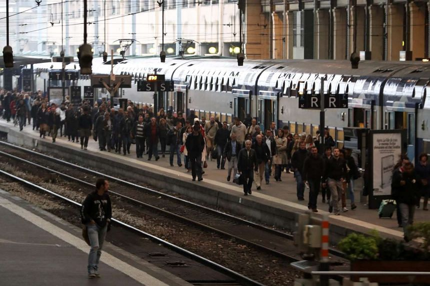 Passengers walk on a platform at the Gare de Lyon railway station on June 1, 2016 at the start of a strike by employees of rail operator SNCF to protest against government labour reforms.