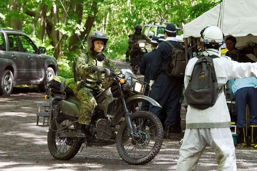 Japanese Self-Defense Force soldiers search for a 7-year-old boy who went missing on May 28, 2016 in  Hokkaido, Japan on June 1, 2016.