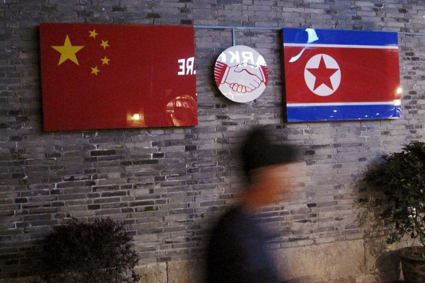 Flags of China and North Korea are seen outside the closed Ryugyong Korean Restaurant in Ningbo, China, on April 12, 2016.