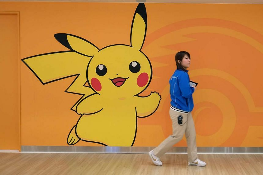 An employee walks past a wall featuring the Pikachu character at the Pokemon Center Mega Tokyo store in Tokyo, Japan.
