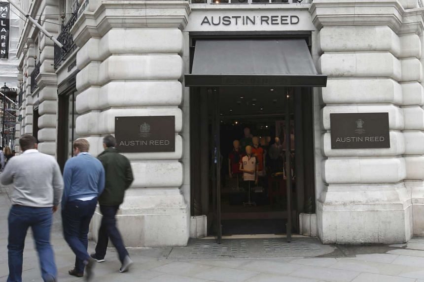 People walk past the Austin Reed store at Regent Street in London, Britain, on April 25, 2016.