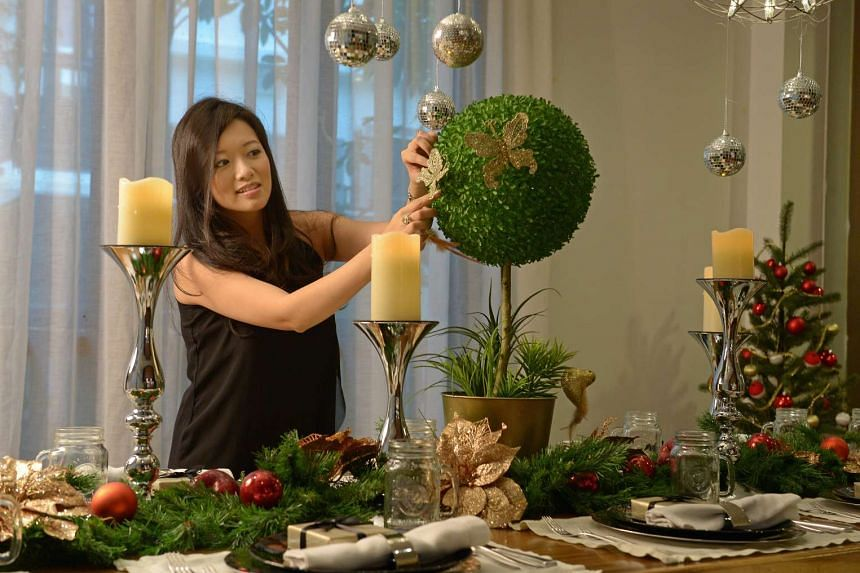 Events company entrepreneur Elaine Kim decorates her dinner table with her own floral arrangements.