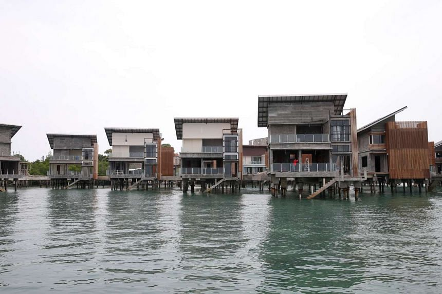 Uncompleted bungalows being built over the sea in the midst of six small islands known collectively as Pulau Manis.