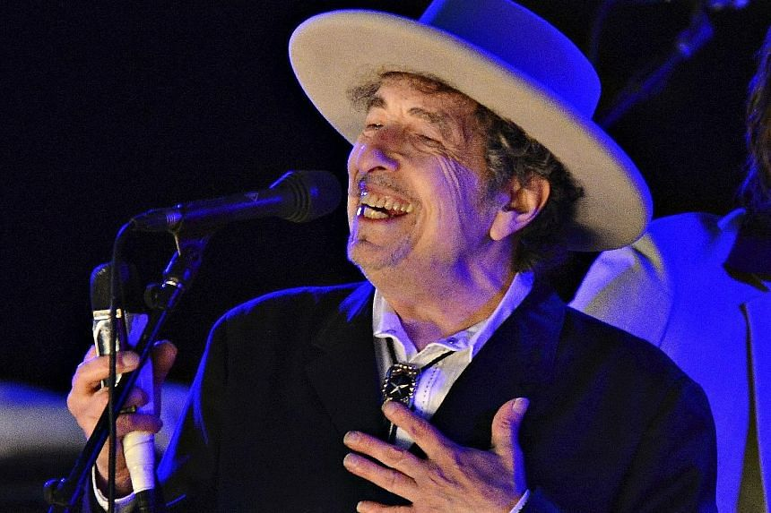 Bob Dylan (above) reinterprets traditional pop tunes, while Eric Clapton gives his take on blues classics.