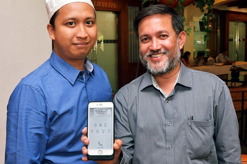 Showing off the new app are Mr Salim Mohamed Nasir (right), head of the Religious Rehabilitation Group (RRG) secretariat, and Mr Ahmad Saiful Rijal Hassan, a counsellor and RRG secretariat member.