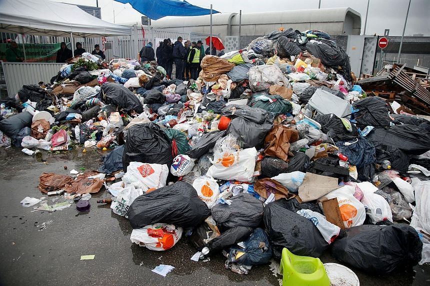 Striking CGT garbage collectors and sewer workers blocking access to the waste treatment centre of Ivry-sur-Seine, near Paris, yesterday in protest against the labour reform Bill.