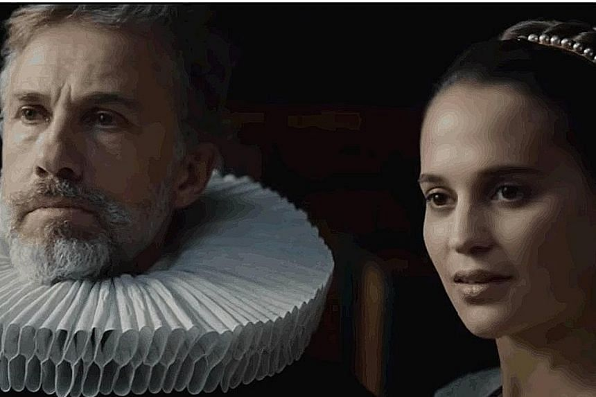 Christoph Waltz and Alicia Vikander (both above).