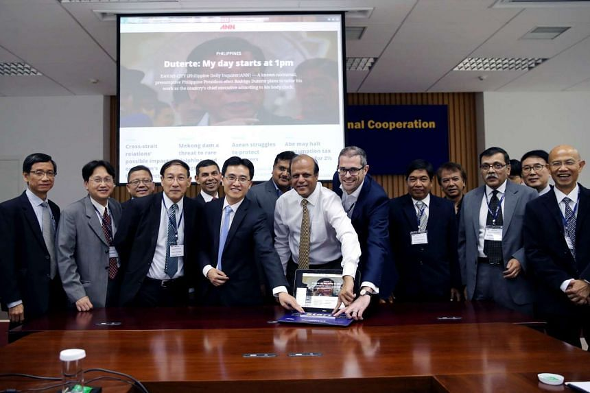 Straits Times Editor Warren Fernandez (fifth from left) together with other editors of the Asia News Network at the launch of the new ANN web site, in Beijing.