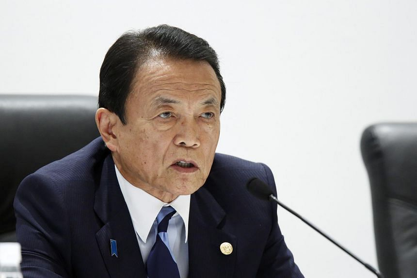 Taro Aso, Japan's deputy prime minister and finance minister, speaks during a news conference following the Group of Seven (G-7) finance ministers and central bank governors meeting in Sendai, Japan.