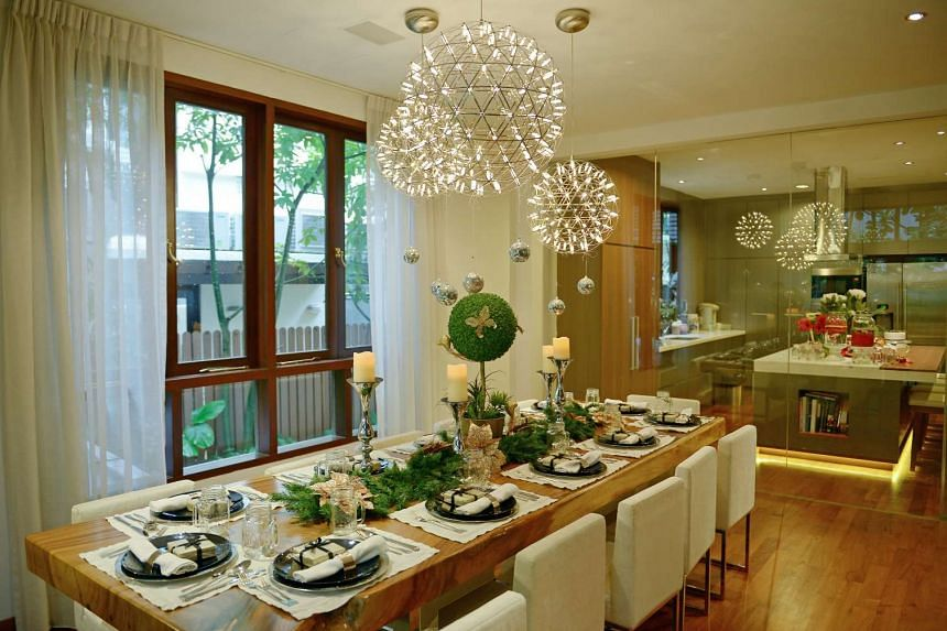 Sit-down dinners at Dr Kim's house are a lavish affair, with no detail spared for the 12-seater table, which is furnished with place settings and ornaments.