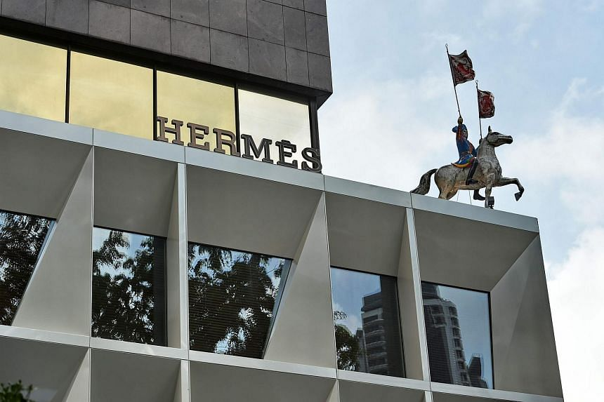 A statue of horseman sits on top a four-storey shop of luxury fashion brand Hermes.