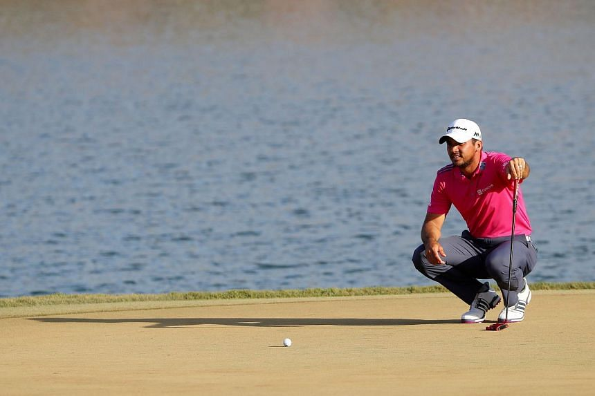 Jason Day lines up a putt on the 17th green during the final round of The Players Championship.