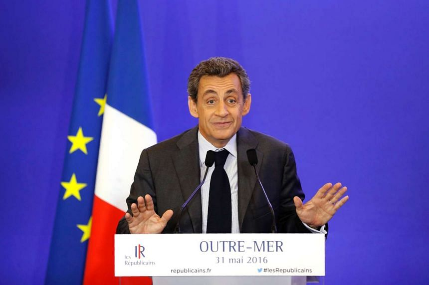 Former president Nicolas Sarkozy gestures as he delivers a speech in Paris, on May 31, 2016.