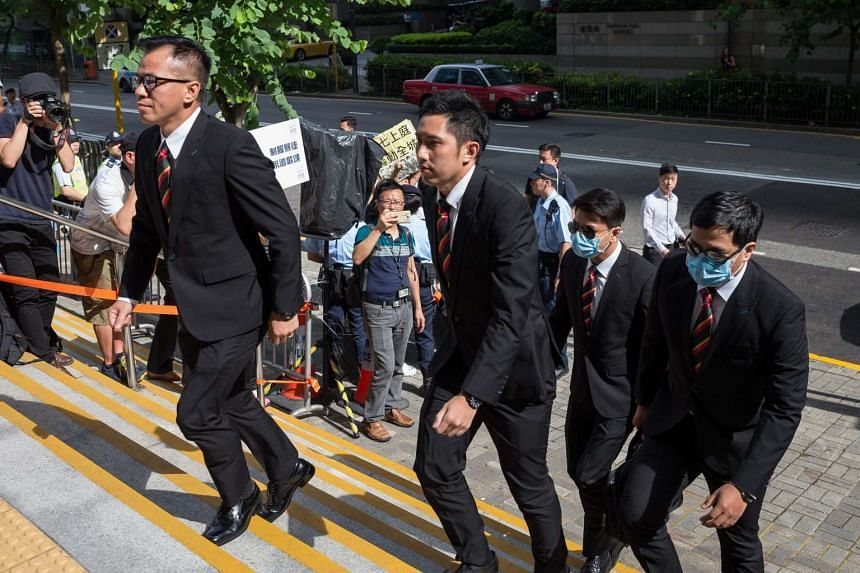 Hong Kong Police officers on trial arrive the Wanchai District Court on the first day of the trial in Hong Kong, on June 1, 2016.