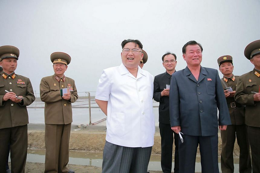 North Korean leader Kim Jong Un (centre) visits the Kwisong Saltern to learn about the salt production.