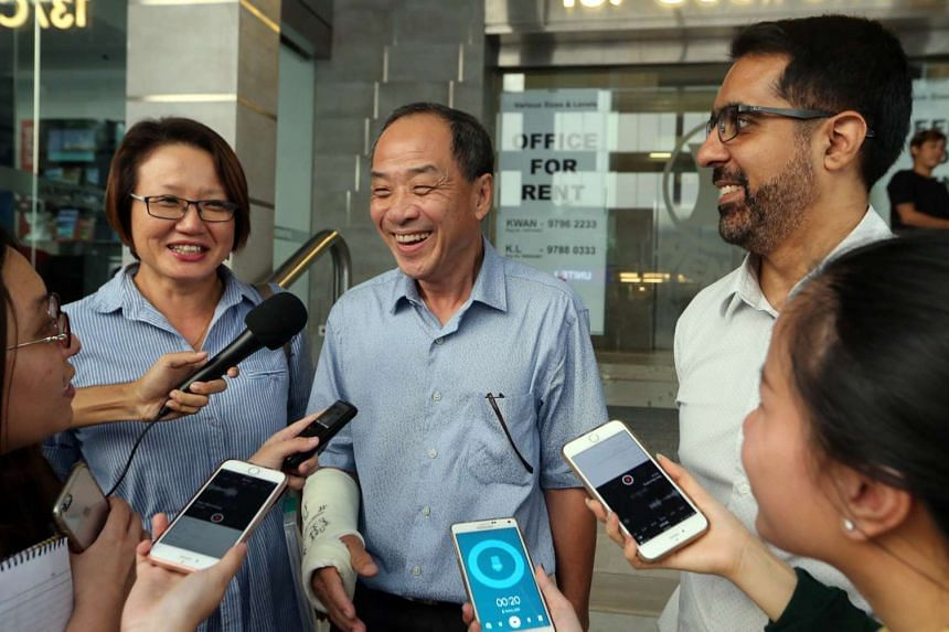 Mr Low (second from left) speaking to the media alongside Ms Sylvia Lim and Mr Pritam Singh on May 29, 2016.