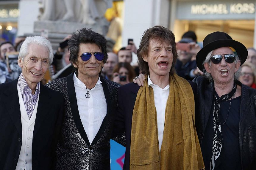 Members of the Rolling Stones (left to right) Charlie Watts, Ronnie Wood, Mick Jagger and Keith Richards arrive for the Exhibitionism opening night gala at the Saatchi Gallery in London.