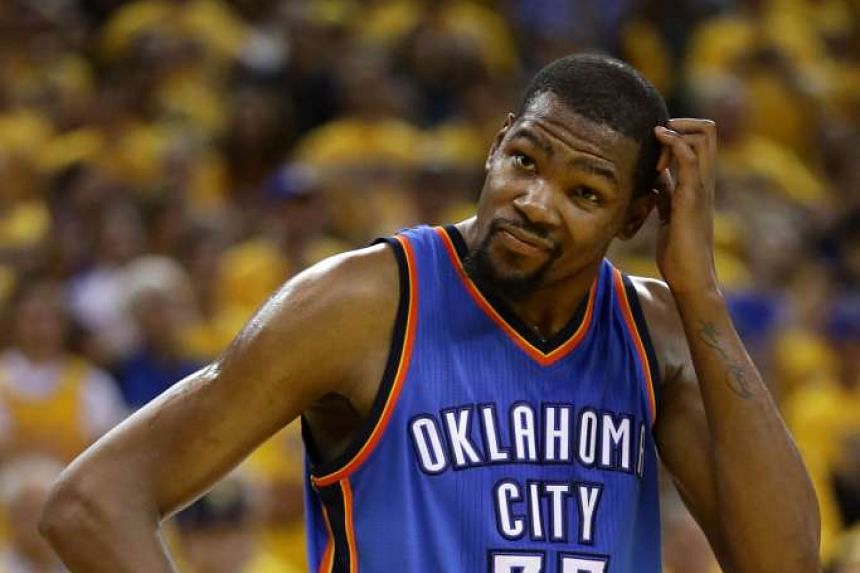 A dejected Kevin Durant, whose 27 points were not enough for his side. Golden State guard Stephen Curry showing his delight after a three-pointer in the fourth quarter to quell Oklahoma City's challenge. The Warriors won 96-88 to clinch the series.
