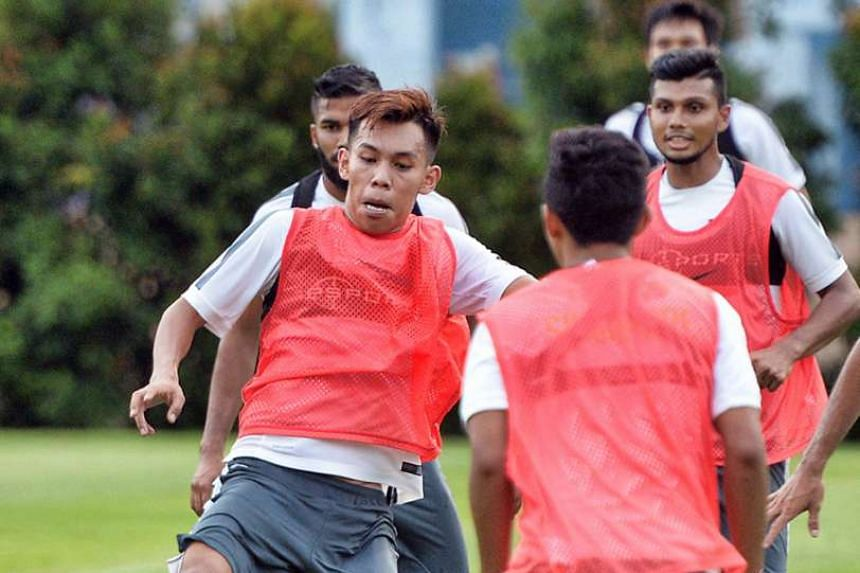 Azhar Sairudin on the ball during Lions training. While the 29-year-old regrets not taking the game more seriously in his youth, he hopes his maturity and development at Home United will earn him a maiden cap.