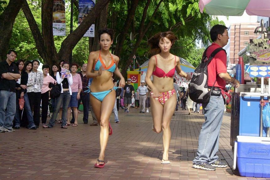 Fiona Xie (left) running along Orchard Road for a TV drama shoot.