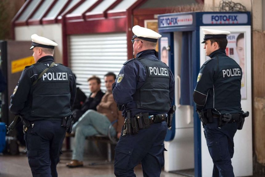 Policemen patrol on March 25, 2016, in front of the main station in Giessen.