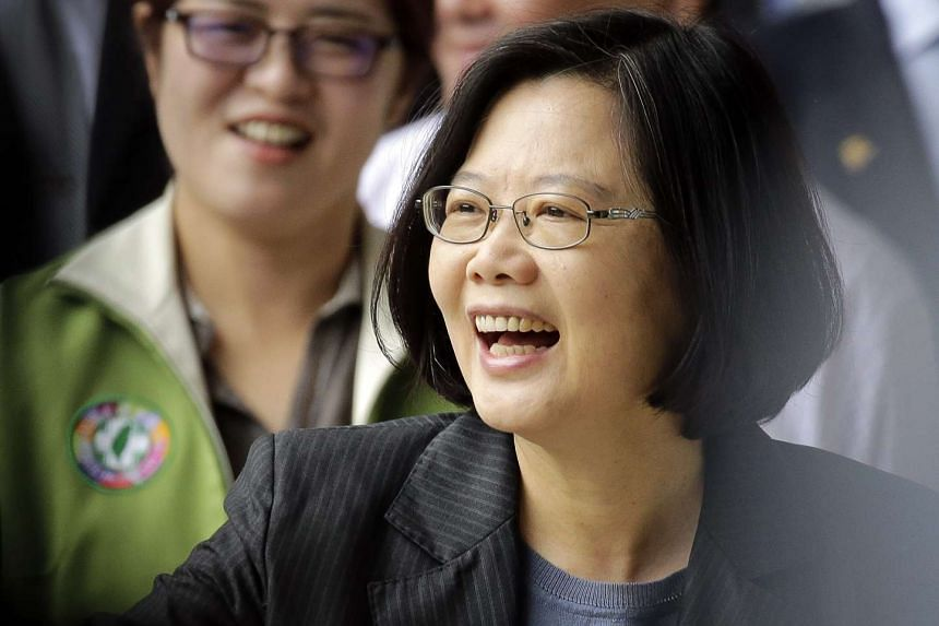 Taiwan President Tsai Ing-wen smiles at supporters as she arrives to vote for party officials in Taipei, Taiwan, on May 22, 2016.