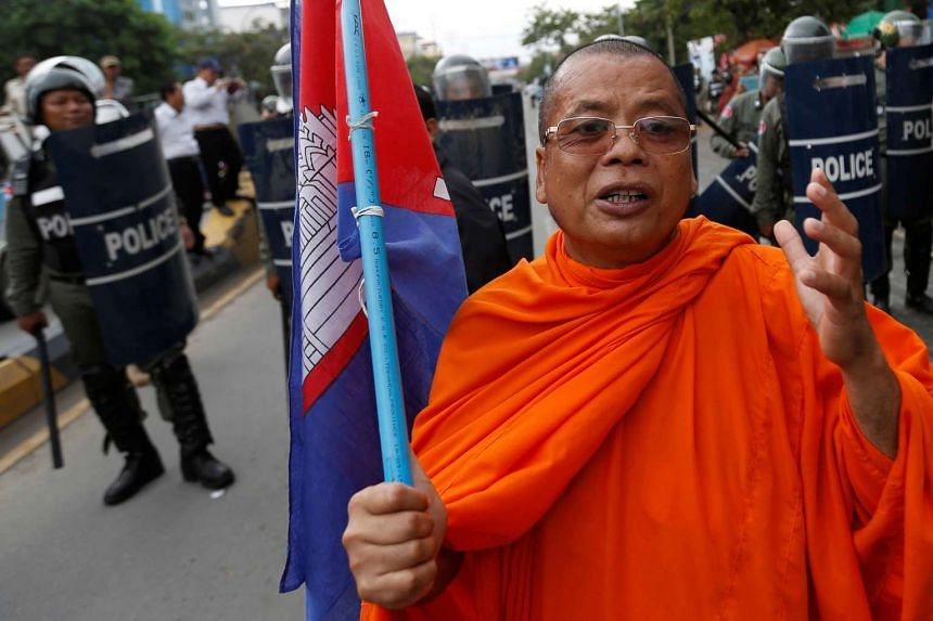 A supporter of opposition CNRP in a march to deliver petition to the Parliament and King Norodom Sihamoni to intervene in the country's political crisis in Phnom Penh, on May 30, 2016.