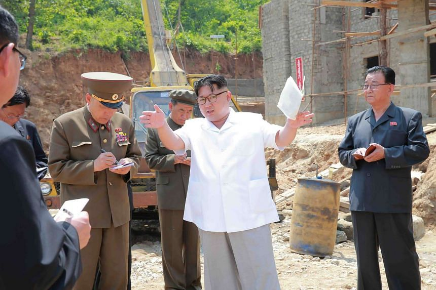 North Korean leader Kim Jong Un (centre) visiting the construction site of the medical oxygen factory in Pyongyang, in an undated picture released on May 30, 2016.