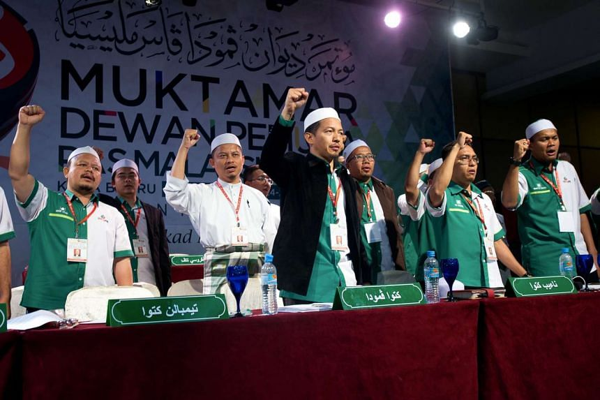 The youth wing chief of Parti Islam SeMalaysia (PAS), Nik Mohamad Abduh (centre), and members of his executive committee, at the annual party assembly in Kota Baru, on June 1.