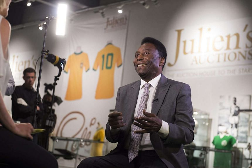 Brazilian football legend Pele attends a preview of an auction of his belongings in London, Britain, on June 1, 2016.