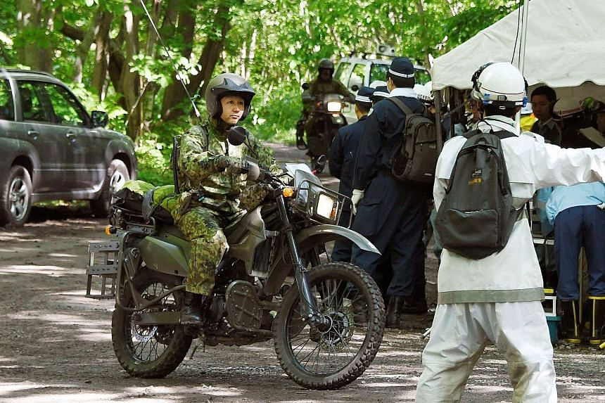 Motorbike-riding soldiers of Japan's Self-Defence Forces yesterday joined the search for a seven-year-old boy who went missing last Saturday. He had been left behind by his parents in a forested area of Hokkaido as punishment for being naughty.