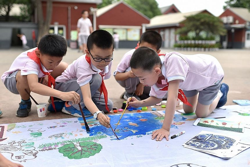 Primary school pupils in Beijing using art to express what they imagine life would be like in outer space in an event to mark International Children's Day yesterday.