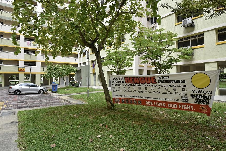 Jalan Tenaga (left), an estate of mostly HDB housing near Eunos, was where the latest dengue victim had lived. However, residents have said they are not worried and have gone about their lives as usual.