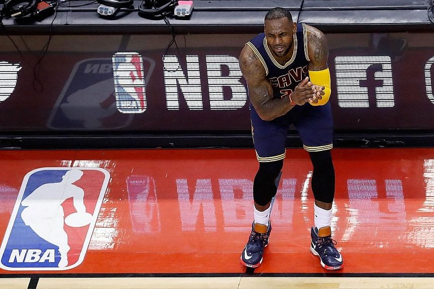 LeBron James urging his fellow Cavaliers on during the Eastern Conference Finals against the Toronto Raptors. He has vowed to make Cleveland NBA champions.