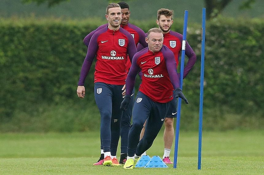 England skipper Wayne Rooney leading the players through their training drills. Their manager Roy Hodgson has picked five natural centre-forwards in his Euro 2016 squad and may look to test his attacking options when they face Portugal at Wembley in