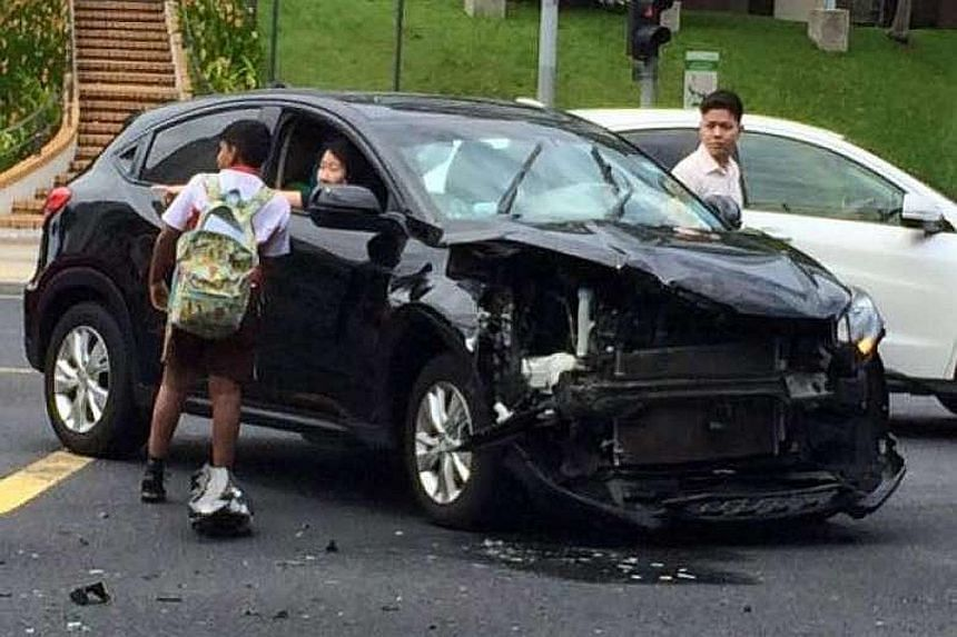 """Ashvin (left) said he ran over to the victims of the accident as many other passers-by were taking photos instead of lending a hand. He added that """"it was just the right thing to do""""."""