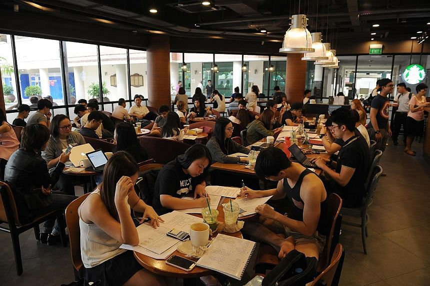 Students at the Starbucks cafe at Bishan Community Club on a weekday afternoon. Some eateries try subtle hints such as clearing the empty dishes or putting up signs discouraging seat-hogging during peak periods. A few have added more tables.