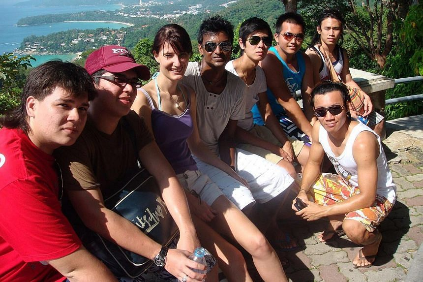 Mr Sivaneswaran Ramalingam (fourth from left) and his girlfriend Sarah Gieghase in happier days, with his friends (clockwise from left) Richard Lumi, Warren John, Isaac Chew, Darius Ow, Darrel Tan and Israel Tan. Mr Siva, who died in Bangkok on Satur