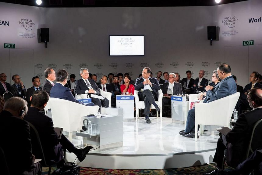 The Straits Times associate editor Ravi Velloor (centre) moderating the panel discussion at the World Economic Forum on Asean, held in Kuala Lumpur.