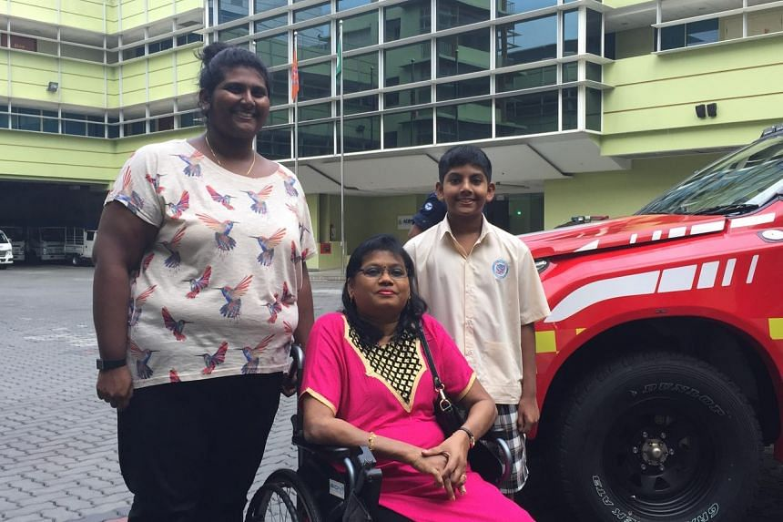 Ashvin with his mother (in wheelchair), Ms Swares Helen Louisa, 50, and sister, Laavanya Gunagegaran, 25, after the award presentation.
