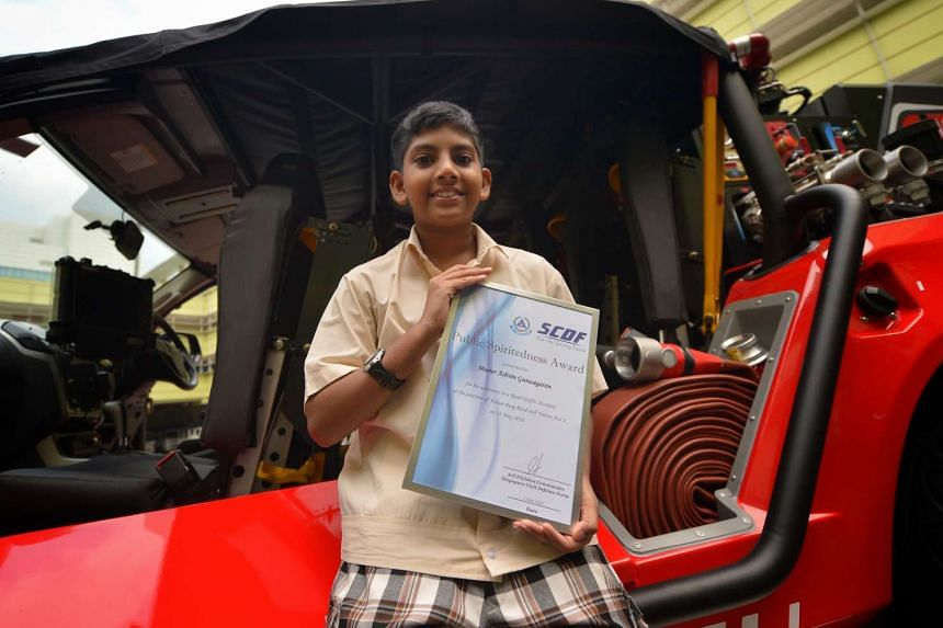 Yishun Primary School pupil Ashvin Gunasegaran was presented with the Public Spiritedness Award by the SCDF for providing help to the victims of a traffic accident.