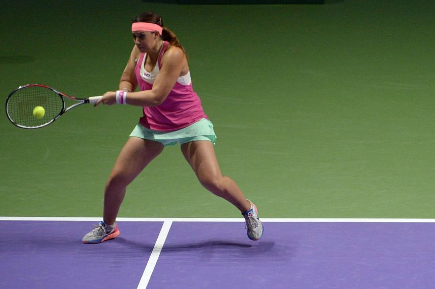 Former Wimbledon champion Marion Bartoli in action during the Legends match at the Singapore Indoor Stadium on Oct 20, 2014.